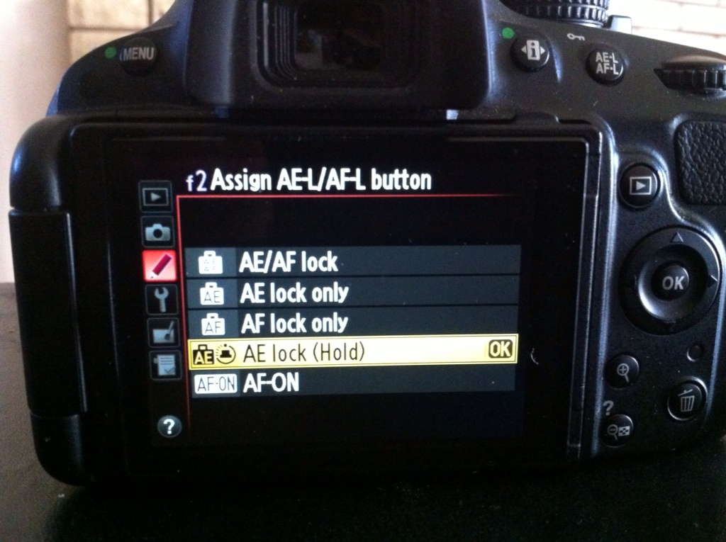 Assigning what the AE/AF lock button does